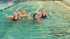 Fit women doing aqua aerobics in the pool Stock Footage