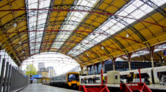 London train departure and commuters inside victoria station Stock Footage