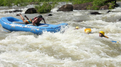 Whitewater Rafting Accident With Persons Floating Downstream - stock footage