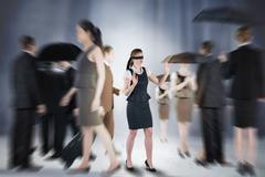 Stock Illustration of Composite image of redhead businesswoman in a blindfold