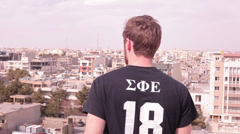 View over City with person frontground Stock Footage