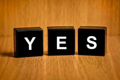 Stock Illustration of yes, ok, agree word on black block