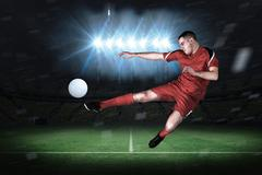 Stock Illustration of Fit football player playing and kicking