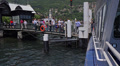 Italy, lake Como. Passengers leave ship moored to wharf. Footage