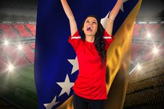 Stock Illustration of Cheering football fan in red holding bosnia flag