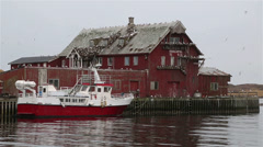 Old rorbu/cabin at harbour in Lofoten, Northern Norway Stock Footage