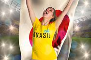 Stock Illustration of Pretty football fan in brasil t-shirt holding japan flag