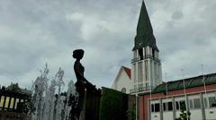 Europe Norway city of Molde 004 church, fountain and statue in city center Stock Footage