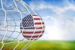 Football in america colours at back of net - stock illustration