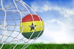 Football in ghana colours at back of net - stock illustration