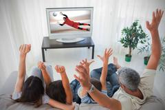 Stock Photo of Family cheering and watching the world cup at home