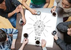 Composite image of people sitting around table drinking coffee - stock photo