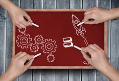 Stock Photo of Composite image of multiple hands drawing doodles with chalk