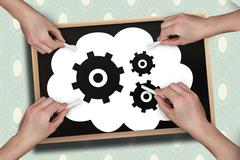 Stock Photo of Composite image of multiple hands drawing cogs with chalk