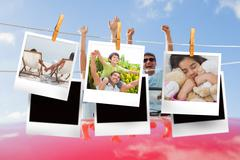 Stock Illustration of Composite image of instant photos hanging on a line
