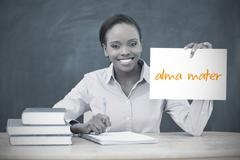 Happy teacher holding page showing alma mater Stock Photos