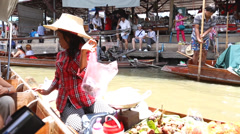 Seller woman offers some products for the tourists, Bangkok Stock Footage