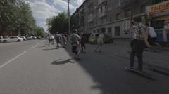 Skateboarders going down the street on a skateboard - filmed in motion Stock Footage