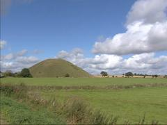Landscape county of Wiltshire + pan Silbury Hill, a man-made chalk mound Stock Footage