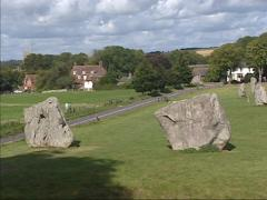 Avebury stone circle and henge + pan road and village Stock Footage