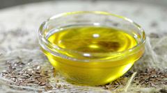 Flaxseed oil (loopable video) Stock Footage