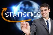 Stock Illustration of Businessman writing the word statistics