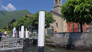 Stock Video Footage of Italy, lake Como. Passengers leave ship moored to wharf.