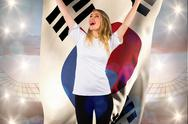 Stock Illustration of Composite image of pretty football fan in white cheering holding korea republic