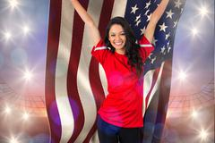 Composite image of cheering football fan in red holding usa flag - stock illustration