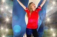 Stock Illustration of Composite image of cheering football fan in red holding honduras flag