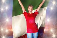 Stock Illustration of Composite image of cheering football fan in red holding italy flag