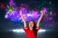 Stock Illustration of Composite image of cheering football fan in red