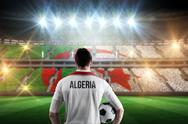 Stock Illustration of Composite image of algeria football player holding ball