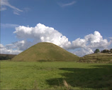 Stock Video Footage of Silbury Hill man-made chalk mound + pan surrounding landscape of Wiltshire.