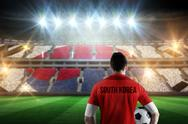 Stock Illustration of Composite image of south korea football player holding ball