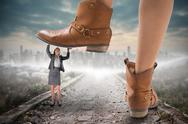 Stock Illustration of Composite image of cowboy boots stepping on businesswoman