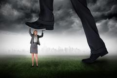 Composite image of businessman stepping on tiny businesswoman - stock illustration