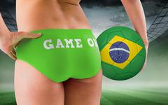 Composite image of fit girl holding brasil ball Stock Photos
