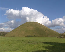 Man-made chalk mound Silbury Hill in county of Wiltshire Stock Footage