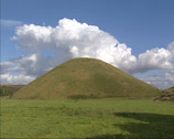 Stock Video Footage of man-made chalk mound Silbury Hill in county of Wiltshire