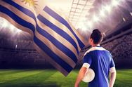 Stock Illustration of Composite image of handsome football player in blue jersey