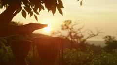 Playing Ethnic Drums Outdoors at Sunset Time Stock Footage
