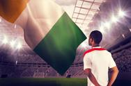 Stock Illustration of Composite image of football fan in white standing