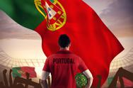 Stock Illustration of Composite image of portugal football player holding ball