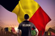 Stock Illustration of Composite image of belgium football player holding ball