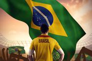 Stock Illustration of Composite image of brasil football player holding ball