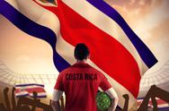 Stock Illustration of Composite image of costa rica football player holding ball