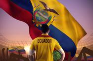 Stock Illustration of Composite image of ecuador football player holding ball