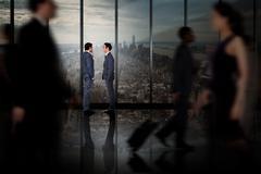 Composite image of businessmen talking - stock photo