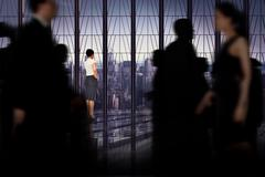 Composite image of business people walking in a blur Stock Photos